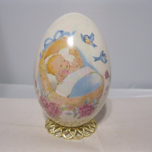 Hand Blown Glass Egg Hand Painted Baby in Cradle